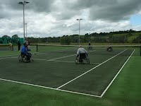 Wheelchair tennis in progress