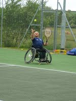 Wheelchair tennis serving