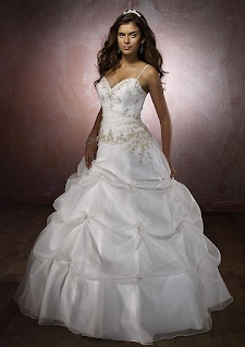 08f578d81f9 This is an example of a traditional quinceanera gown. It is the young  woman s first formal adult attire. The dress signals that the young woman  is moving ...