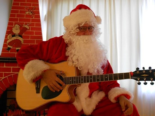 Click here for https://sites.google.com/site/rockinsantaclaus/home