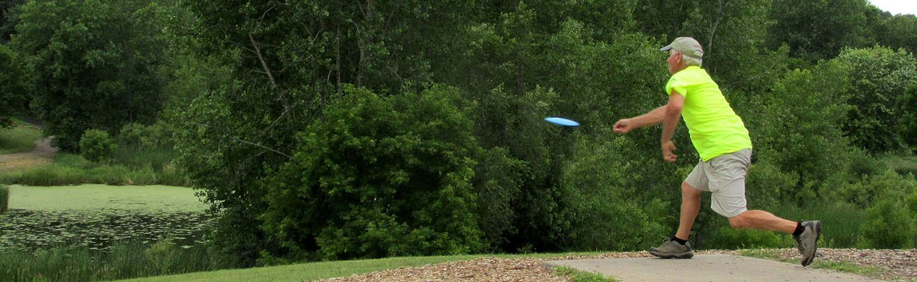 person playing disc golf