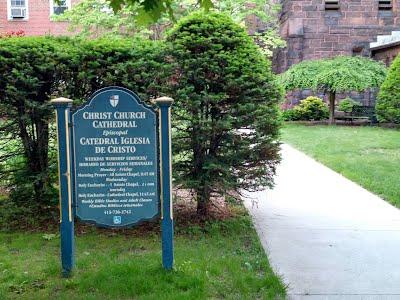 Church Sign next to courtyard entrance