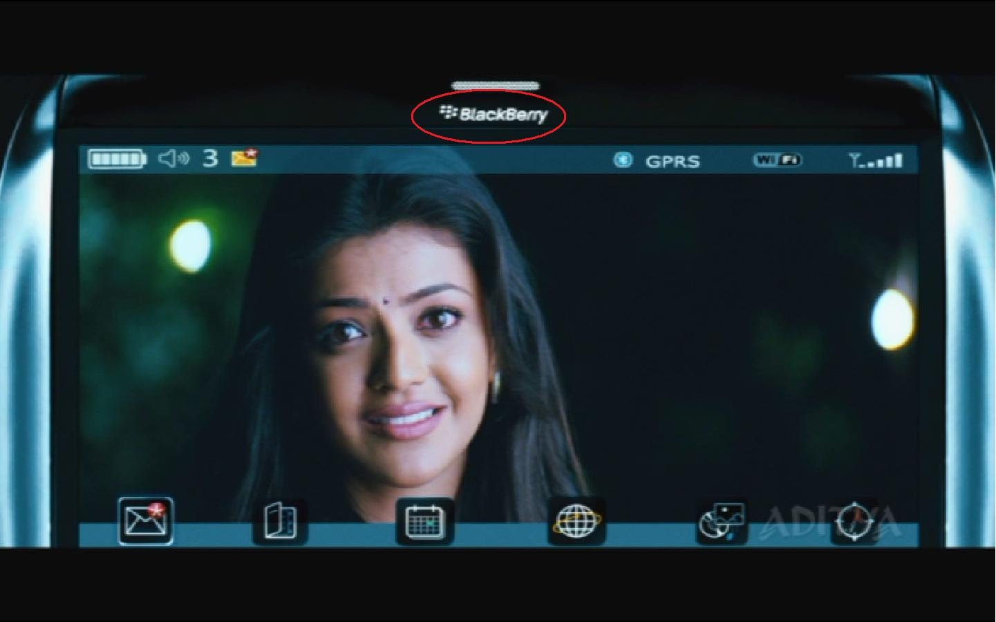Kajal seen on blackberry by Prabhas