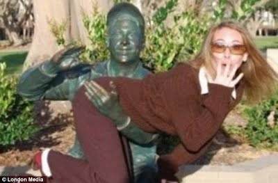 Posing with statues 17