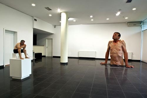 Solo art exhibit showing his sculptures self portrait and ordinary man