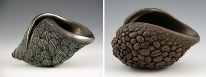 hand carved sculptures of swirling feathers and another sculpture of coffee beans swirling by artist jacques vesery