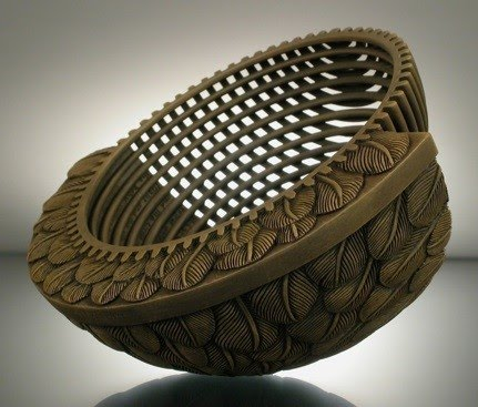modern mechanical sculptured pot with one half of it carved with feathers by artist jacques vesery