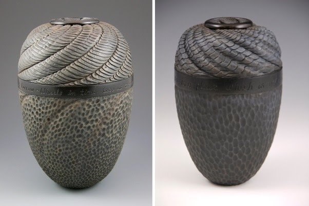 two charcoal colored modern vases twist at the top