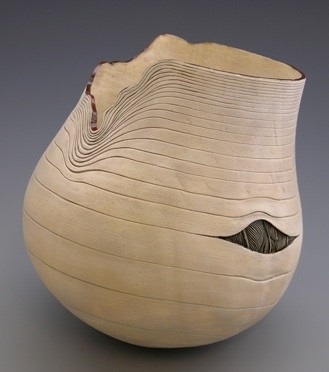 faux wood sculpture vase with crack showing feathers by jacques vesery