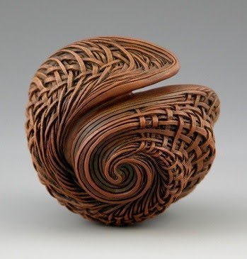 hand carved sculpture of faux wicker twisting into a swirl by sculptor jacques vesery