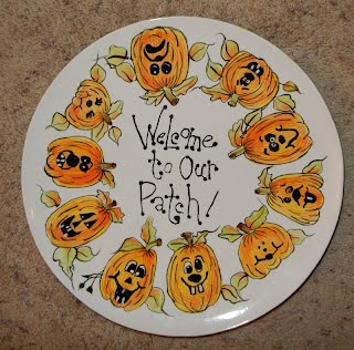 http://www.ebay.com/itm/13-Ceramic-Halloween-Platter-WELCOME-TO-OUR-PATCH-Hand-Painted-Glazed-by-me-/222583283212?hash=item33d2ff5e0c:g:jjQAAOSwrDBZaw~f