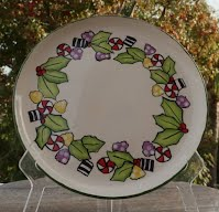 https://www.ebay.com/itm/My-10-Holly-Platter-with-Holly-and-Candy-HAND-PAINTED-GLAZED-by-me/222723502702
