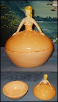 https://www.ebay.com/itm/Ceramic-Princess-Trinket-Box-Brown-Eyed-Blonde-Orange-Gown-Glazed-by-me/222701328599?hash=item33da0898d7:g:LSMAAOSwWZ9Xn9G2