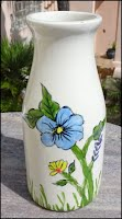 https://www.ebay.com/itm/My-Milk-Bottle-Vase-with-Blue-Yellow-Flowers-HAND-PAINTED-GLAZED-by-me-TTT/224315692620?hash=item343a41d64c:g:3bkAAOSw0Nxf~7CO
