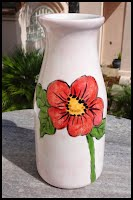 https://www.ebay.com/itm/My-Ceramic-Milk-Bottle-Vase-with-Orange-Flower-HAND-PAINTED-GLAZED-by-me-TTT/224315700898?hash=item343a41f6a2:g:MhIAAOSwmXJf~7fn