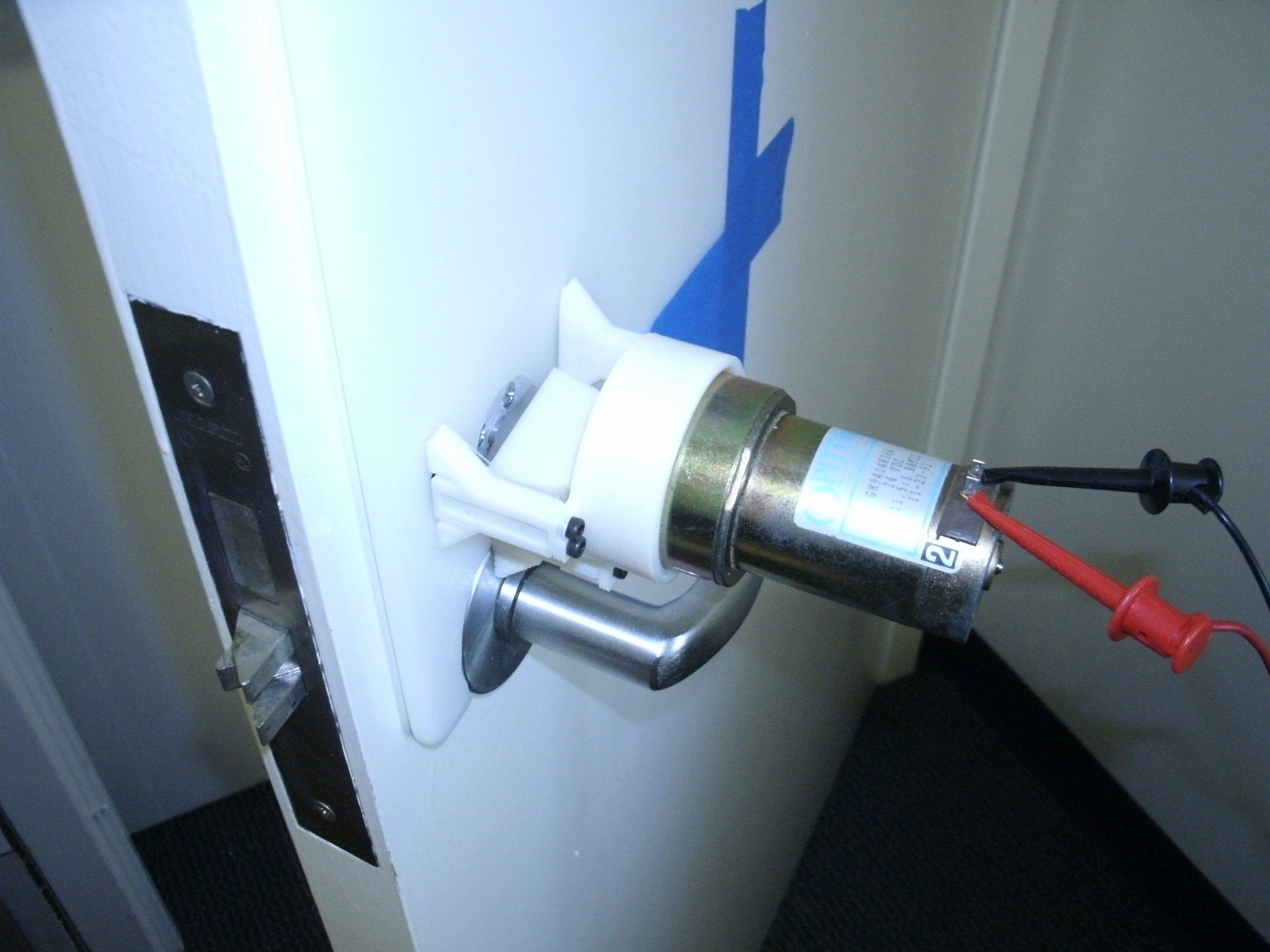 Motor with attached mounting hardware Test setup for lock actuation demo & RFID Door Unlocker - CMU Projects