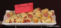 warm, tasty mummy dogs - hot dogs wrapped in pastry