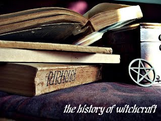 A photo of a pile of old books, a small box, and a metallic pentagram, which is labeled The History of Witchcraft.