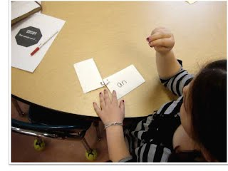 Student using sign language to learn sight words
