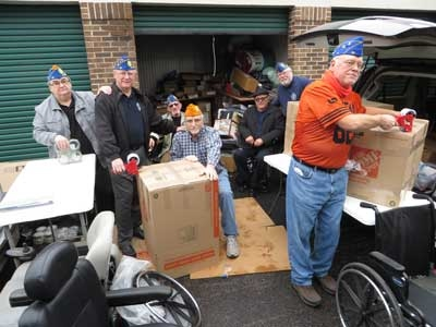 Ukrainian American Veterans Post 32 packing Wheelchairs for Ukrainian Wounded