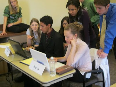 Students Working Around a Computer at UNM Mun