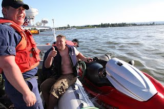 The US Coast Guard Auxiliary rescues a recreational boater on the Columbia River, outside Portland, Oregon