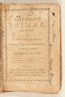 "Cover of an aged book which reads ""The New-England Primer"" and has some scribbles on it"