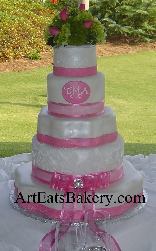 5 Tier white and pink fondant custom unique wedding cake design with ribbons, bow, and fresh flower topper idea picture