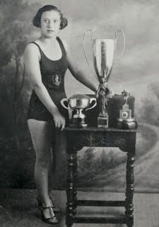 Beatrice Wolstenholme with swimming trophies c1932